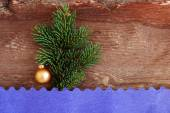 New Year's toy on a fir-tree branch on a wooden background — ストック写真