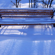 Lonely bench in snow — Stock Photo #58500349