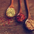 Spices in wooden spoons — Stock Photo #58746427