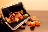 Balticamber stones in an old purse — Stock Photo