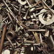 Background from old rusty bolts, screws, nuts, screws, brackets, various metal details — Stock Photo #66601995