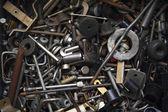Background from old rusty bolts, screws, nuts, screws, brackets, various metal details — Zdjęcie stockowe