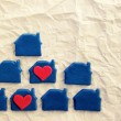 Two red hearts in blue lodges from plasticine on the white rumpled made old paper — Stock Photo #66639889