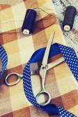 Scissors, threads, fabric and blue tape — Stock fotografie