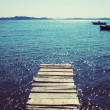 Old wooden pier from boards going to the sea — Stock Photo #78748458
