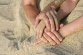 Mother and the son intertwined hands on a beach. — Stock Photo