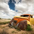 Scrap vintage car in the desert — Stock Photo #57098987