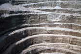 Wall of modern diamond open mine - abstract background — Stock Photo