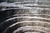 Wall of modern diamond open mine - abstract background — Stock Photo