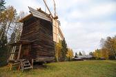 Windmill in rural area neaby forest — Foto de Stock