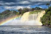 Powerful waterfall and a rainbow in tropics — Foto de Stock