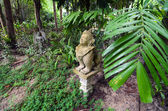 White stone statue of a religious creature lost in tropical park — Stock Photo