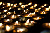 Lit candles in the darkness — Stock Photo