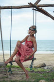 Young Hippie Woman on a Swing Enjoying Summer Day at the Seaside — Stock Photo