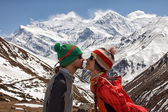 Lovers in funny hats in mountains — Stock Photo