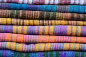 Colorful scarves at a market in Nepal. Colors of textiles. — Stock Photo