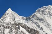 Snowy mountain peak - beauty of nature — Stock Photo