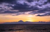 Stunning Sunset of Vibrant Colors on a Seaside with Volcano at the background — Stock Photo
