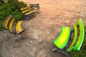 Few colorful benches oposit each other on a brick square - traditional Thailand — Stock Photo