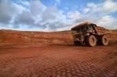 Closeup of a loaded tip-truck in an open mine — Foto de Stock