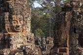 Stone faces in Bayon temple in ancient city Angkor — Stock Photo