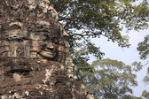 Stone face in Bayon temple in ancient city Angkor — Stock Photo