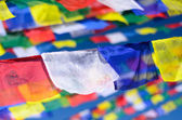 Colorful Buddhist prayer flags on the wind — Stock Photo