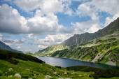 Lake high in mountains in summer — Stock Photo