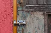 Closeup of red wall and vintage door locked with latch — Stock Photo