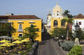 View to old town of Cartagena - summer restaurant, Cathedral and houses in Colonial style — Stock Photo