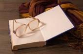 Old glasses lying on the book — Stock Photo