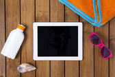 Tablet pc on the deck with summer concept — Stock Photo