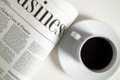 Coffee cup and newspaper — Stock Photo