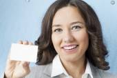 Businesswoman giving blank business card — Stock Photo