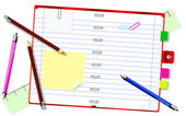Notepad with pencils and pens — Stockfoto