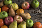 Fruits on wooden table — Stock Photo