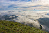 Hiker at sunrise over the clouds, mount Cucco, Apennines, Umbria — Stok fotoğraf