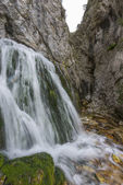 Waterfall in autumn in the forest, mount Cucco NP, Umbria, Italy — Stockfoto