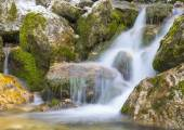 Waterfall in autumn in the forest, mount Cucco NP, Umbria, Italy — Stock Photo
