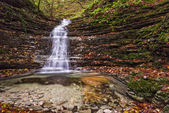 Waterfall in the forest in autumn, Monte Cucco NP, Umbria, Italy — Stockfoto