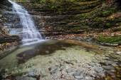 Waterfall in the forest in autumn, Monte Cucco NP, Umbria, Italy — Stok fotoğraf