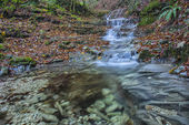 Waterfall in the forest in autumn, Monte Cucco NP, Umbria, Italy — Zdjęcie stockowe