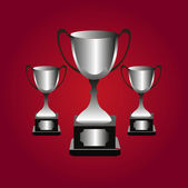 Trophies on red background — Stock Vector