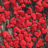 Valentine day background with satin red hearts — Stock Photo
