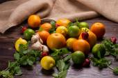 Various fruits scattered on a wooden background. — Stock Photo