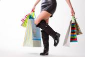 Lady in rubber boots and leather skirt. — Stock Photo