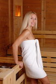 Blond girl enjoying in sauna — Stock Photo