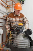 Service Man Working on Furnace — Stock Photo