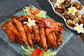 Grilled king prawns and shells — Stock Photo