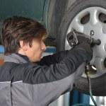 Auto mechanic working under the car — Stock Photo #57239379